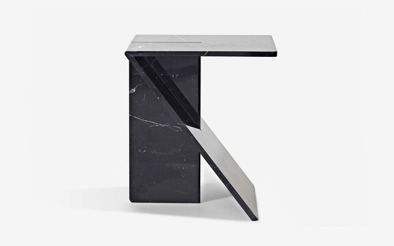 The architecture of the minimum. The perfect compromise between the mass of matter used and the economy of means used to make it. Clé is a side table available in white Carrara or black Marquina marble.  Clé is part of the Feather Light Marble