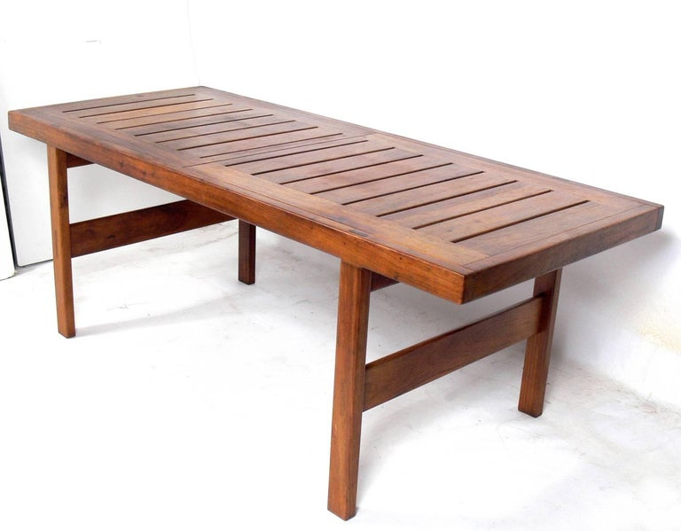 Clean lined midcentury dining table, designed by John Tabraham for Kallenbach, South African, circa 1960s. Retains wonderful original patina. Clearly inspired by Danish modern design, but with clean lines and little ornamentation, save for the