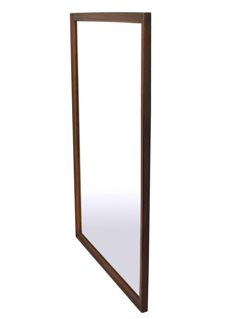 Clean lined walnut mirror by Kipp Stewart for Drexel, American, circa 1950s. Retains it's warm original patina. Has been cleaned and Danish oiled. Can be hung vertically or horizontally, just let us know which you prefer.