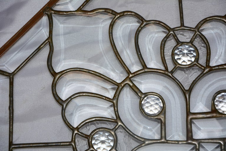 Bevelled, crackled and wavy describe the different styles of antique glass that have been repurposed in this stunning design. The glass is framed in copper in the style of stained glass art. The glass originated in New England and was repurposed in