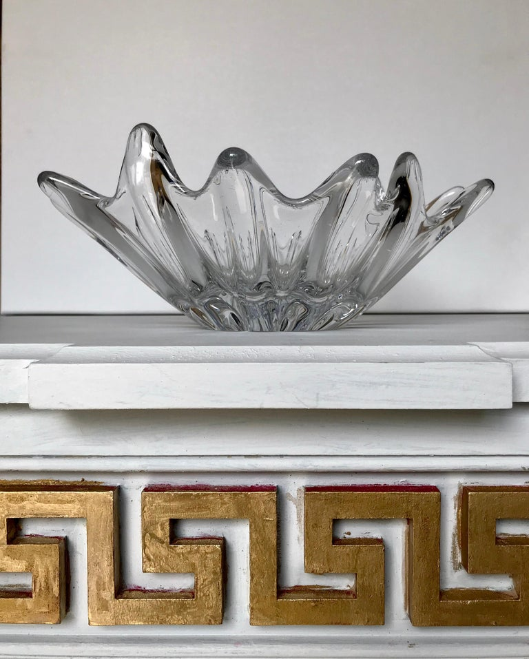 A sculptural and modern leaded glass bowl by Daum, one of the most illustrious glass makers of the 20th century in Nancy, France, circa 1950. Daum was awarded a Grand Prix during the 1900, Universal Exhibition for their exquisite glass pieces. The