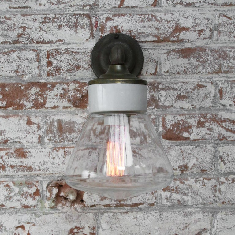 Clear Glass Brass Vintage Cast Iron Arm Scones Wall Lights In Good Condition For Sale In Amsterdam, NL