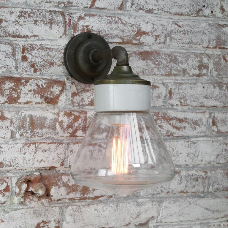 20th Century Clear Glass Brass Vintage Cast Iron Arm Scones Wall Lights For Sale