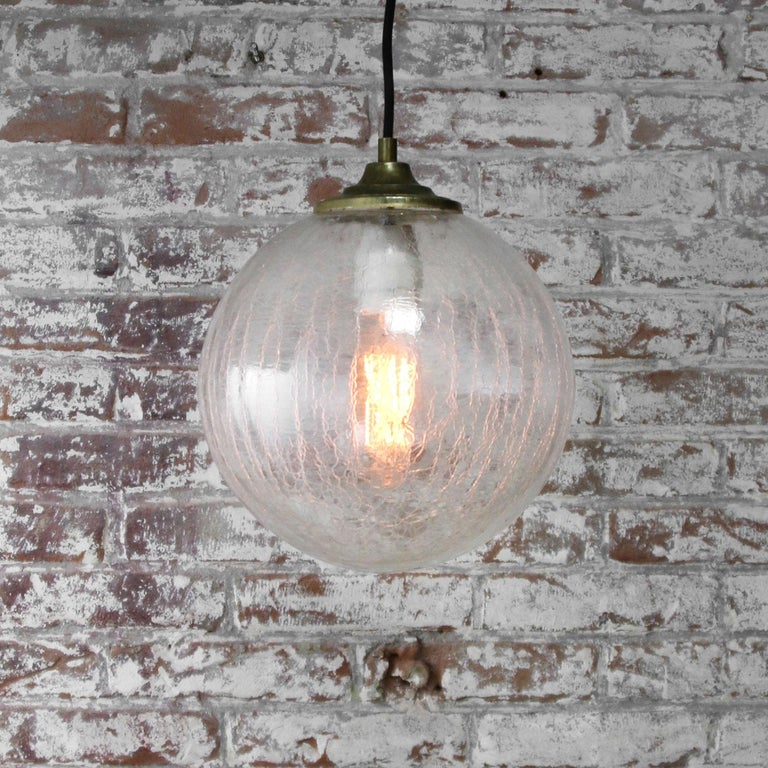 Clear Glass Globe Vintage European Brass Top Pendant Lights In Good Condition For Sale In Amsterdam, NL