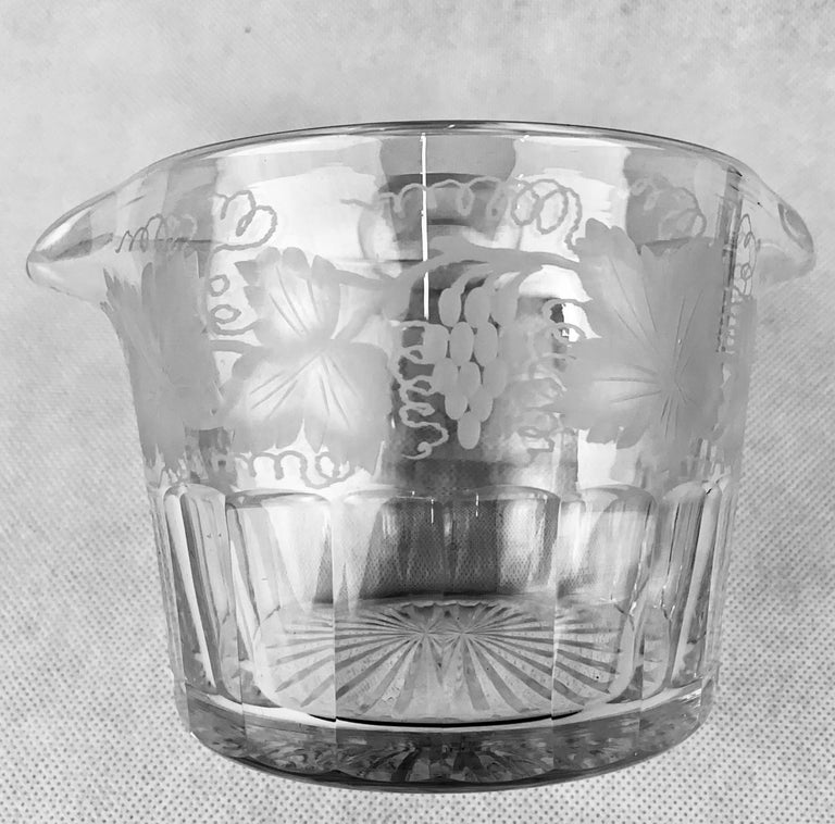 Victorian engraved and cut glass double lipped hand blown wine rinser with a pattern of grapes and leaves. The bottom half of this piece has thumb cut panels or slice cut panels while the bottom is star cut. Today these are quite often used for