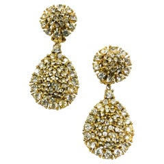Clear paste and gilt metal drop earrings, Ciner, USA, 1980s.