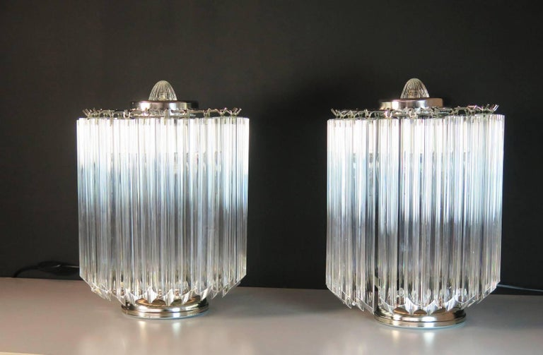 Magnificent pair of table lamps, 24 quadriedri for each lamp. Elegant object of furniture. Period: late 20th century. Dimensions: 15 inches (38 cm) height; 10.50 inches (27 cm) diameter. Dimension glasses: 11 inches (28 cm) height. Light bulbs:
