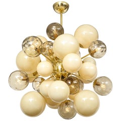 Clear Smoked and Opaque Ivory Murano Glass and Brass Sputnik Chandelier, Italy