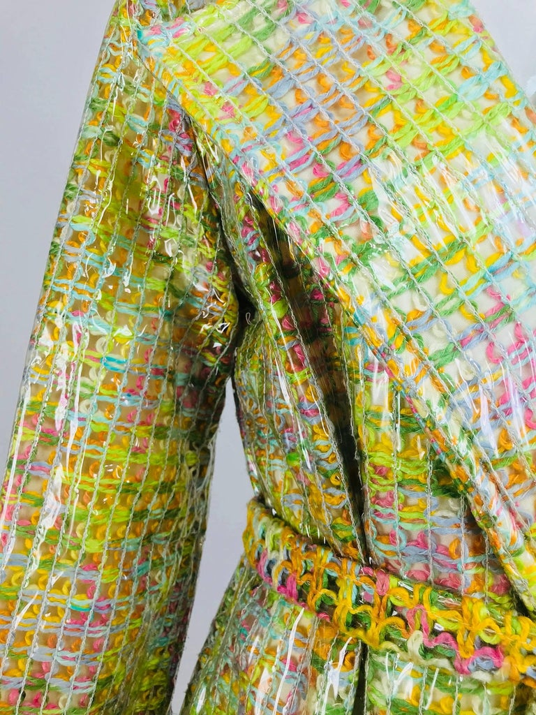 Clear vinyl covered tweed novelty rain coat with belt from the 1960s...Unusual rain coat from the 1970s, unfortunately the label has been removed, but it does retain the original size 10 tag. Clear vinyl coat is quilted over a woven fabric in