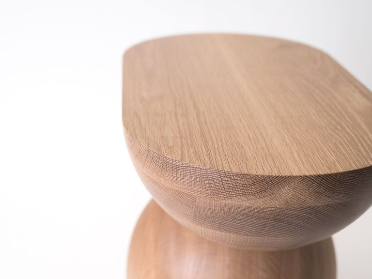 The Cleave side table is handcrafted out of solid white oak. The Cleave is built by gluing two chunks of oak together with a layer of paper between. After handing turning it into shape, it is