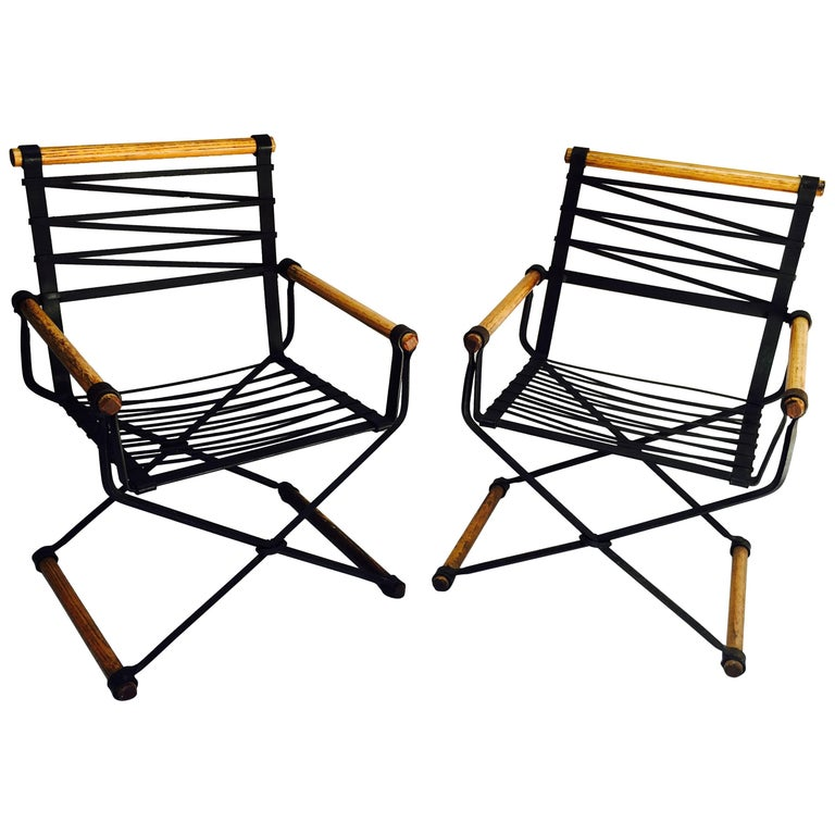 A pair of handcrafted wrought iron armchairs designed by Cleo Baldon and produced at her studio/work shop Terra in the 1960s. The chairs and their cushions are in excellent condition.