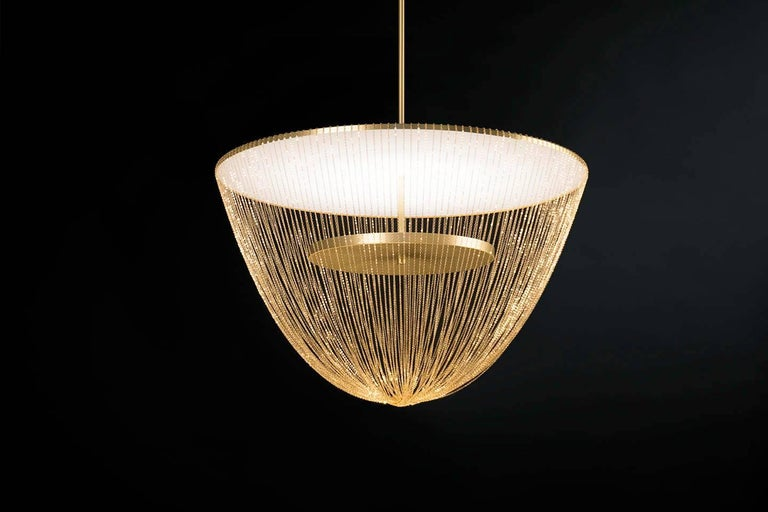 Céleste is a luxurious high-end lighting fixture that has been coated with warmth and elegance. This sculptural light is handcrafted with delicate copper chains to create a unique and elegant curved shape inspired by the romantic world of jewelry.