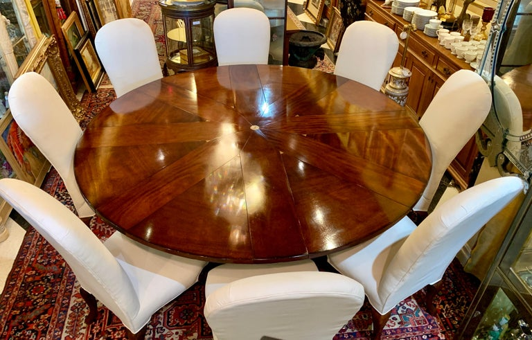 Couture designer Oscar De La Renta for Century Furniture Company dining set includes a handcrafted, distressed mahogany finish, Oscar De La Renta Star Pattern radial expansion round dining table, 8 matching Oscar De La Renta high back upholstered