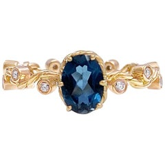Clio London Blue Topaz Twist Vine Solitaire 18 Karat