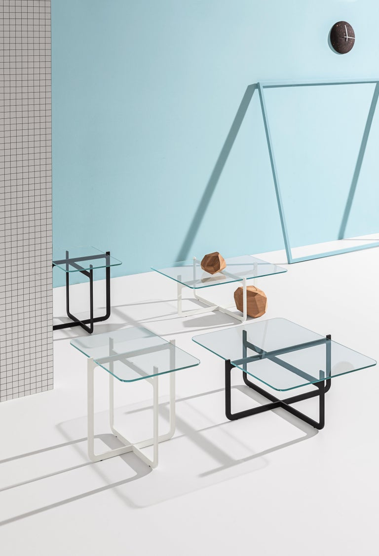 Coffee table with laser-cut, welded metal lacquered in black and tempered extra clear glass top.  Nendo seeks simplicity and minimalism with this combination of metal and glass. Clip comes to life from the concept of two steel sheets cut out like