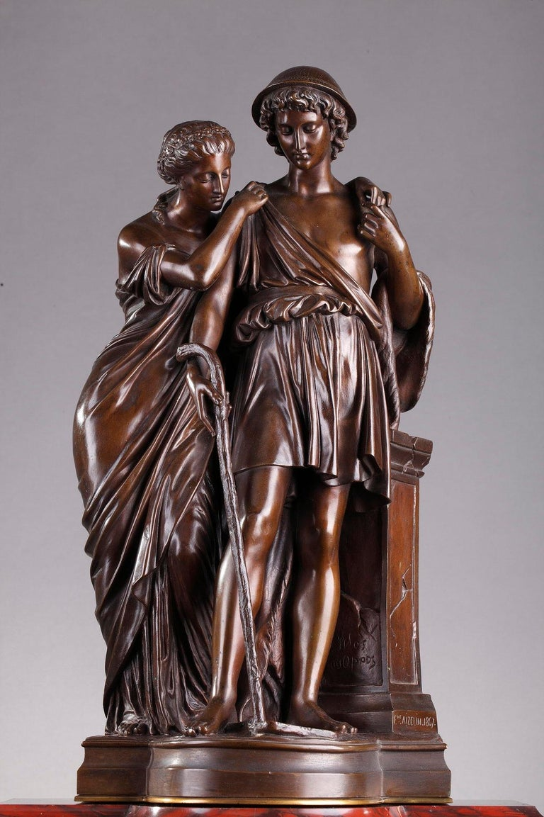 Red Griotte mantel (fireplace) clock decorated with a patinated bronze group, Les bergers d'Arcadie (Shepherds of Arcadia) by Eugene-Antoine Aizelin (1821-1902), featuring a maiden and a shepherd mourning at a tomb. The woman is wearing a flowing