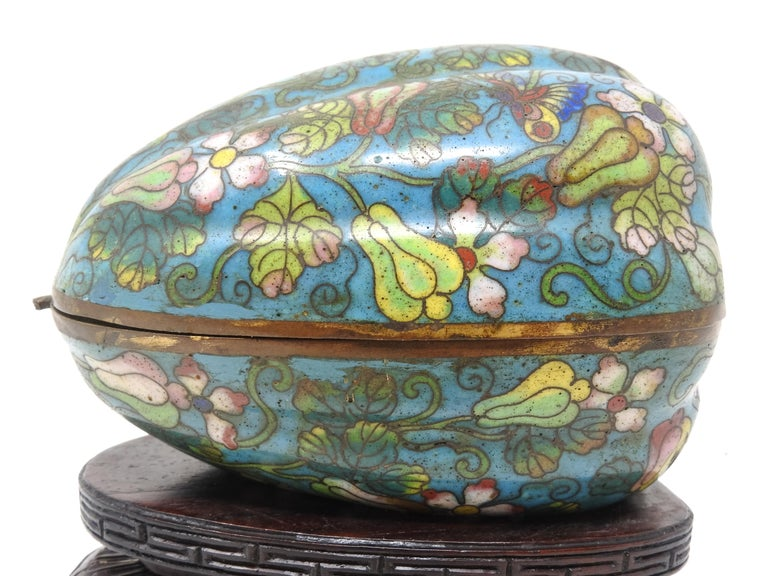 Up for your consideration is this gorgeous cloisonné artichoke trinket box. It starts with a base that has been hand carved with beautiful scrollwork and Greek keys. The artichoke sits perfectly in its spot that was carved out for it. The box is