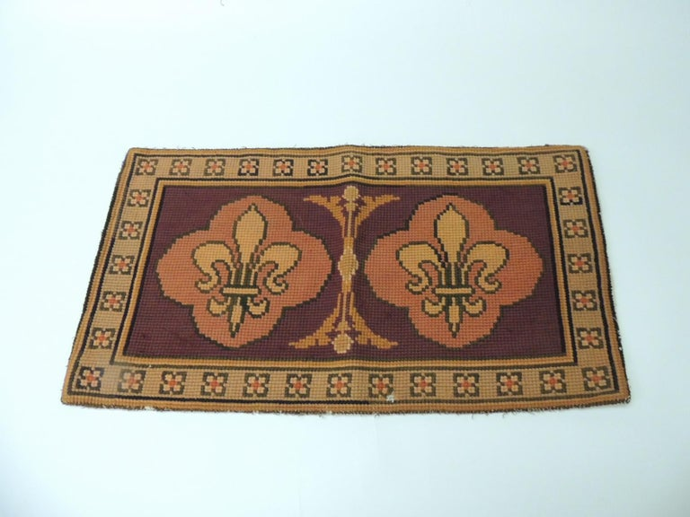 Vintage Fleur-de-Lis orange and red tapestry Stylized Fleur-de-Lis tapestry from the 1940s and framed with a floral border. Tapestry panel is in shades of orange, black, red and coral. Size: 24 x 13.