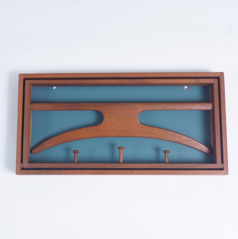 Scandinavian Modern Valet in teak and leather by Adam Hoff and Poul Østergaard, Denmark For Sale