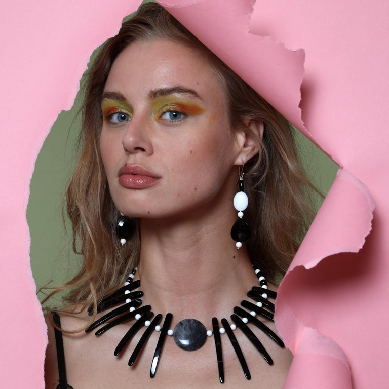 """Exuberant set composed by extraordinary earrings and necklace in white and black agate with a """"cloudy"""" agate central medallion. Shows a brave and dramatic bold tribal warrior fearless and unique jewel piece. The earrings are a perfect match of black"""