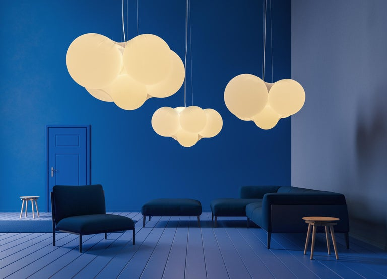 Designed by Dima Loginoff, Cloudy is a true luminous sculpture that dominates the space with its presence and diffuses a soft and cosy light.  Five spherical elements of different dimensions wrapped in a semi-transparent elastic fabric, form