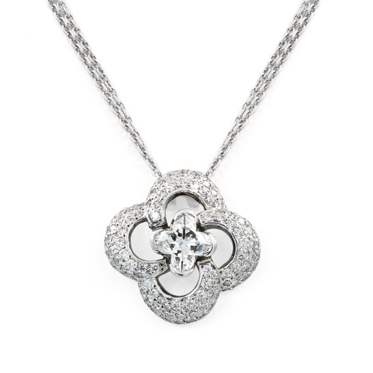 This elegant necklace in platinum has a Lili-cut diamond in the center H in color, VS2 in clarity = .88ct. and 104 ideal cut round diamonds= .75ct. t.w. set in a