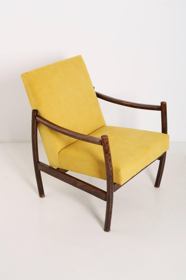 Armchairs produced in the 1960s by Radom Furniture Factories. Very comfortable seat covered with high quality fabric. The armchairs are fully carpentry and upholstery. We can prepare other color versions of fabrics.