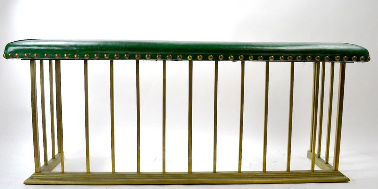 Nice tailored style club, Bench Fender, with upholstered (vinyl) seat and large brass stud nail heads. The body is brass with square stock and brass molding trim at the base. The brass finish is patinated, as expected from age and use. no structural