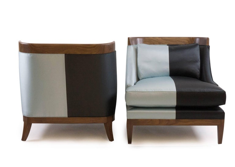 Original design by Jhon Ortiz. Manufactured in Norwalk CT. Hand-carved exposed walnut with oil finish. Extra-stuffed down cushions finished with two colors of silk. Deep seat that is comfortable and elegant.  Fabric upholstery is