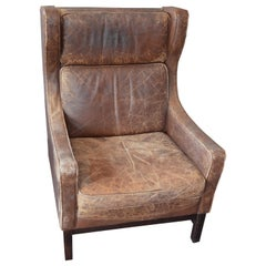 Club Chair of Worn Leather from Edwardian England, Wingback, Early 20th Century