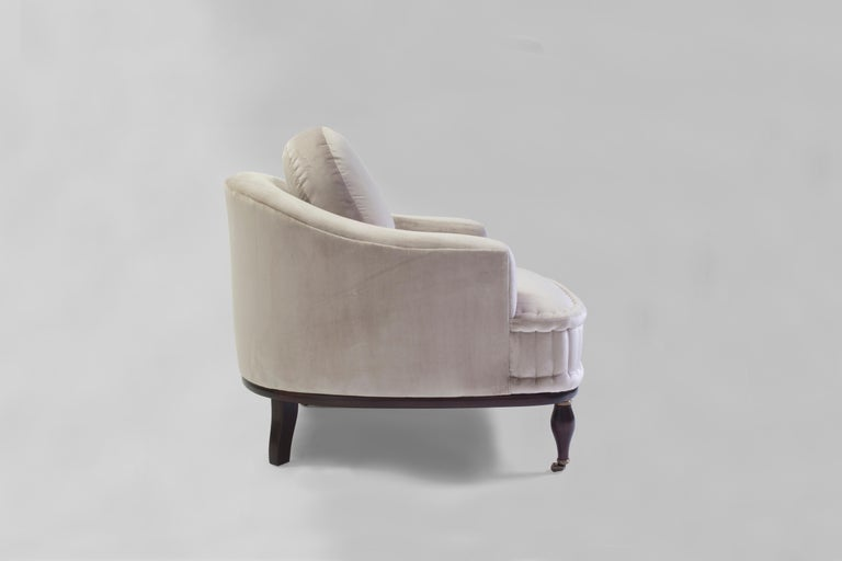 The Gladys club chair is a deco Classic beauty with loose back cushion made of feather and down and square back and arms with clean seams - it has a solid seat with hand-stitched rolled mattress edges as done in the old school upholstery technique -