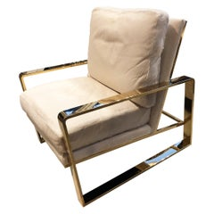 Club Chair with White Cowhide and Brass Frame