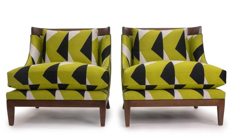 Original design by Jhon Ortiz. Manufactured in Norwalk CT. Hand-carved exposed walnut with oil finish. Extra-stuffed down cushions upholstered in Pierre Frey Ida/citrine. Deep seat that is comfortable and elegant.  Fabric upholstery is