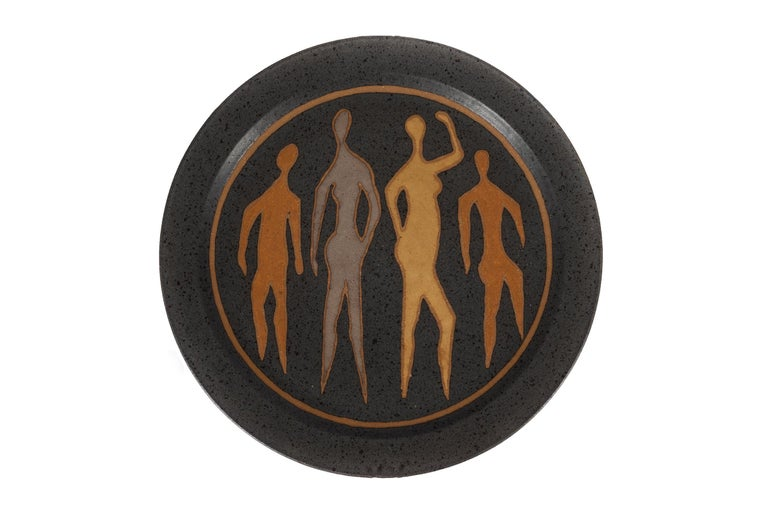 Clyde Burt ceramic charger in glazed stoneware with incised image. Signature to underside: [CB]. American, circa 1965.