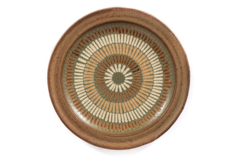 Clyde Burt ceramic platter glazed stoneware with incised, abstract details. Signed to underside: [CB]. American, circa 1965.
