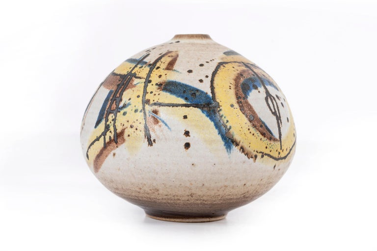 Clyde Burt ceramic vase in glazed stoneware with abstract multicolored glaze.