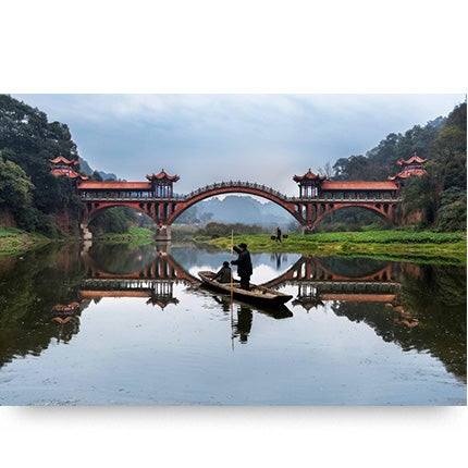 Steve McCurry, Man Rows on Min River, Leshan, China, 2016