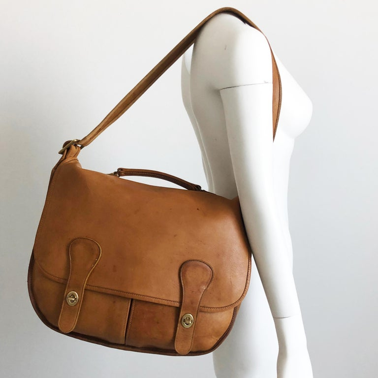 Authentic, preowned, vintage (and rare!) 60s Coach Bonnie Cashin 'Swag Bag' large leather messenger bag.  Made in NYC & extremely hard to find, especially in this condition! Made from incredible saddle leather, with top handle & adjustable/removable