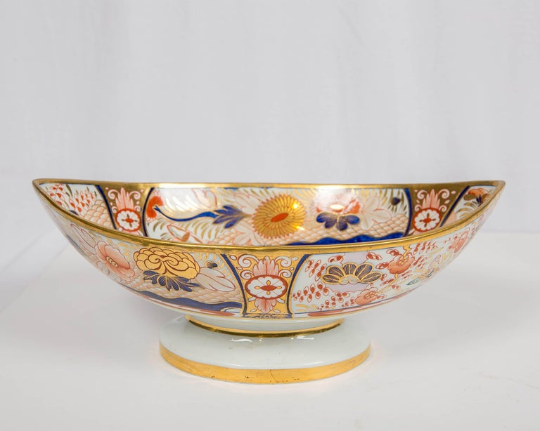 Why We Love It: The intensity of the Imari colors and the wonderful pink spotted lion. This Coalport Admiral Nelson pattern centerpiece was hand painted in England during the Regency period circa 1810. It is decorated in a traditional, vibrant