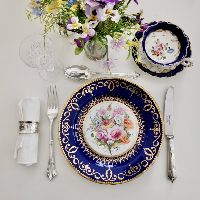 This is a very rare plate made by John Rose in Coalport in about 1805. The plate has a beautiful cobalt blue ground, rich gilding and a stunning flower painting in the centre. There are still a few plates of this service around (I had one a while