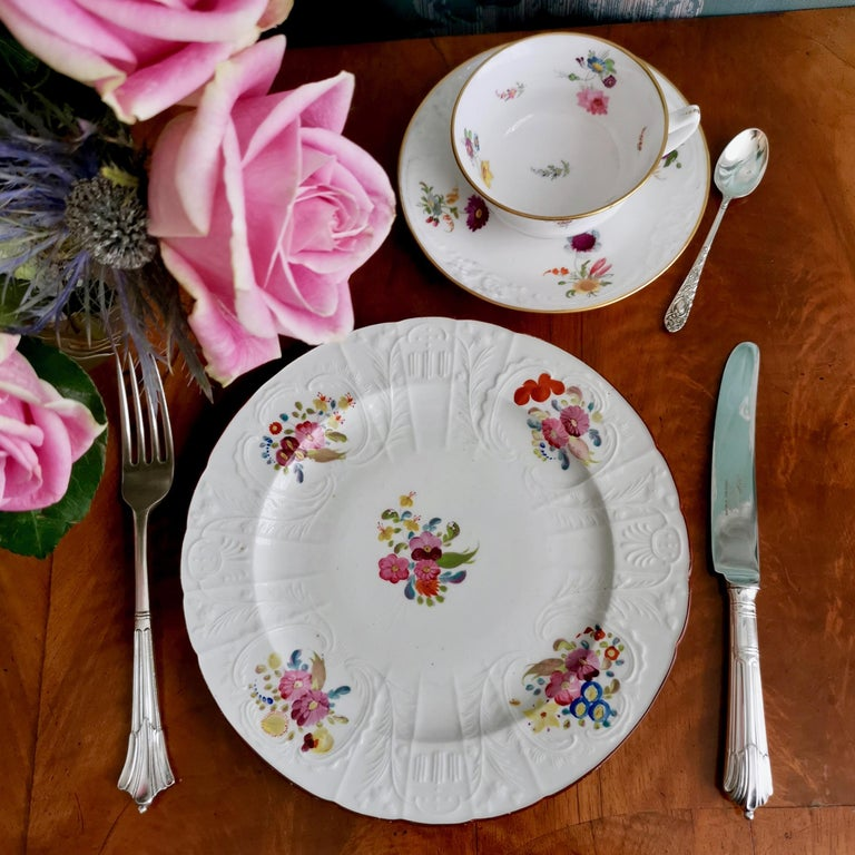 This is a beautiful dessert plate made by Coalport in circa 1815.  Coalport was one of the leading potters in 19th and 20th century Staffordshire. They worked alongside other great potters such as Spode, Davenport and Minton, and came out with