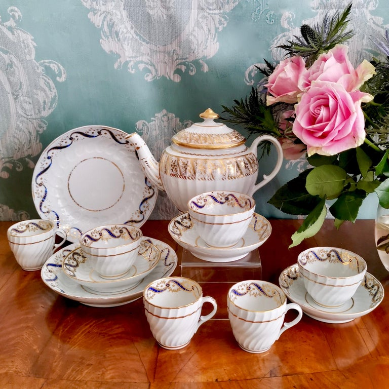 This is a beautiful tea service made by John Rose (Early Coalport) in circa 1795. The service consists of a lidded teapot, two cake plates, and three trios each consisting of a saucer, a teacup and a coffee cup.  This little service would make a