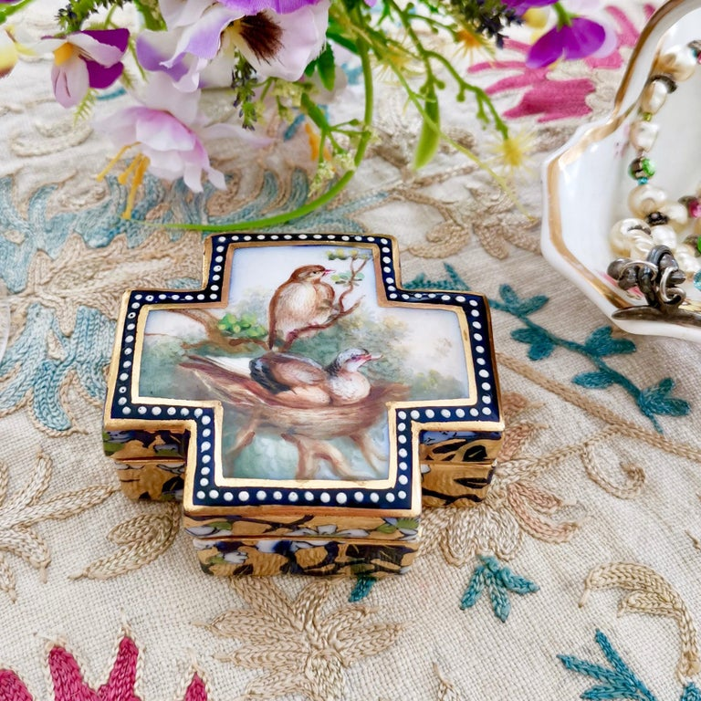 This is a beautiful and rare trinket box made by Coalport probably between 1865 and 1870. It was painted with birds on their nest by the famous porcelain bird painter John Randall, and it is an exceptionally beautiful example of Randall's style in
