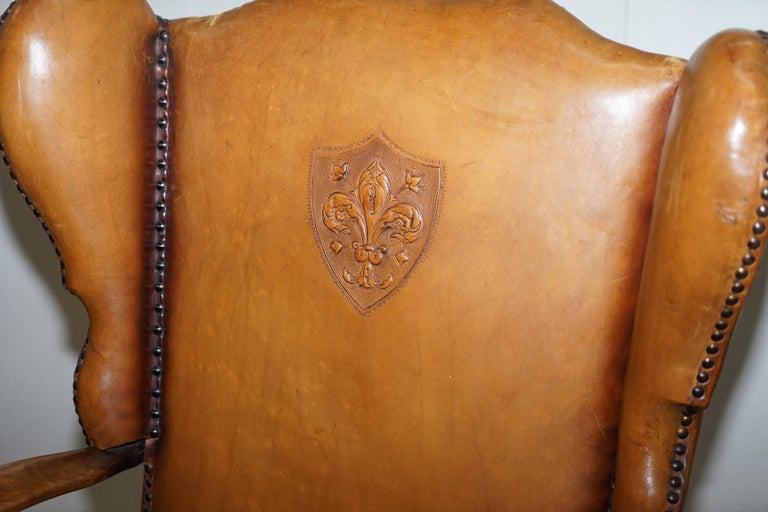 Hand-Carved Coat of Arms Armorial Crest Edwardian Oak and Brown Leather Wingback Armchairs For Sale