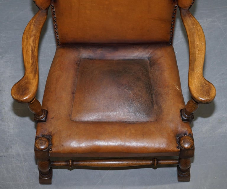 20th Century Coat of Arms Armorial Crest Edwardian Oak and Brown Leather Wingback Armchairs For Sale