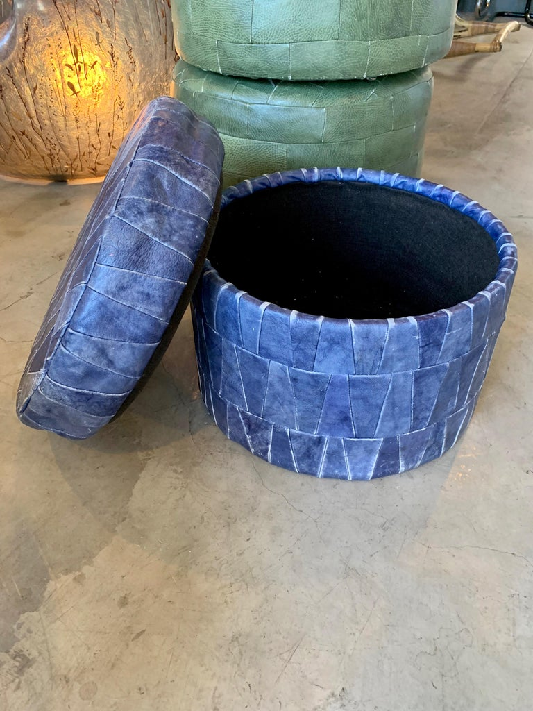 Patchwork leather storage ottoman by De Sede in cobalt blue. Ottoman has a lid with storage inside. Good condition. Great accent piece and nice scale.