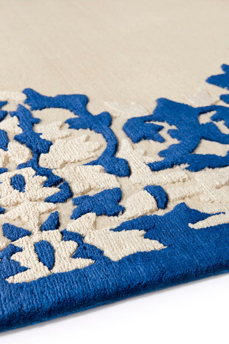 Drawing on Rodarte's personal experience growing up in California, Cobalt is inspired by 1970s, Northern California interiors, and the ubiquitous blue and white porcelain of their childhood. The striking beauty of the rug lies in the decorative