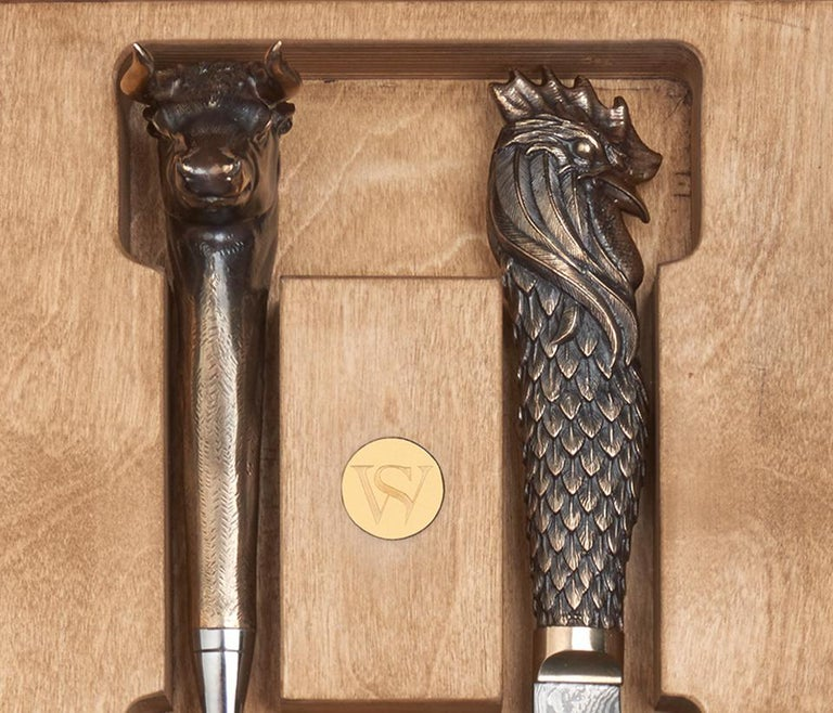 Cock and Bull Carving Knives - All with folded steel blades and bronze handles featuring one with a cock head and one with a bull head.   Spanning four vibrant decades, Stephen Webster's eponymous brand has become internationally renowned for