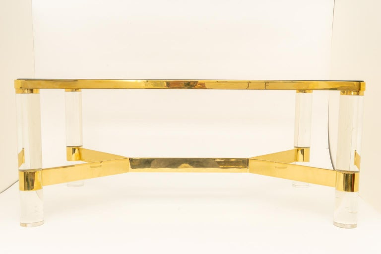 This stylish and chic cocktail table dates to the 1980s and was created by the iconic American furniture designer Karl Springer. The piece was acquired from a Palm Beach estate.