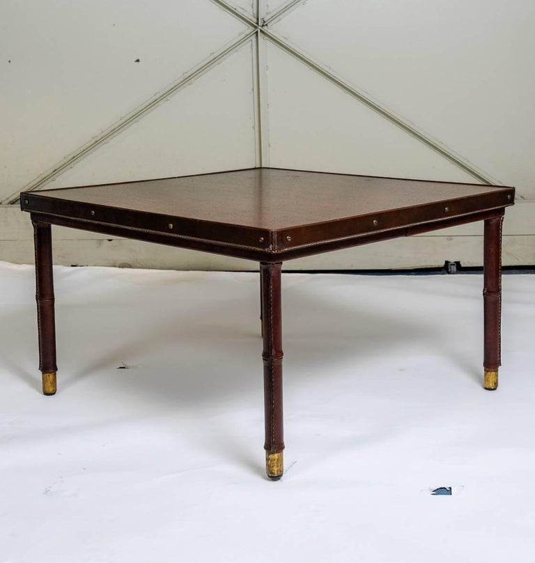 Mid-20th Century Cocktail Table in Stitched Leather by Jacques Adnet For Sale